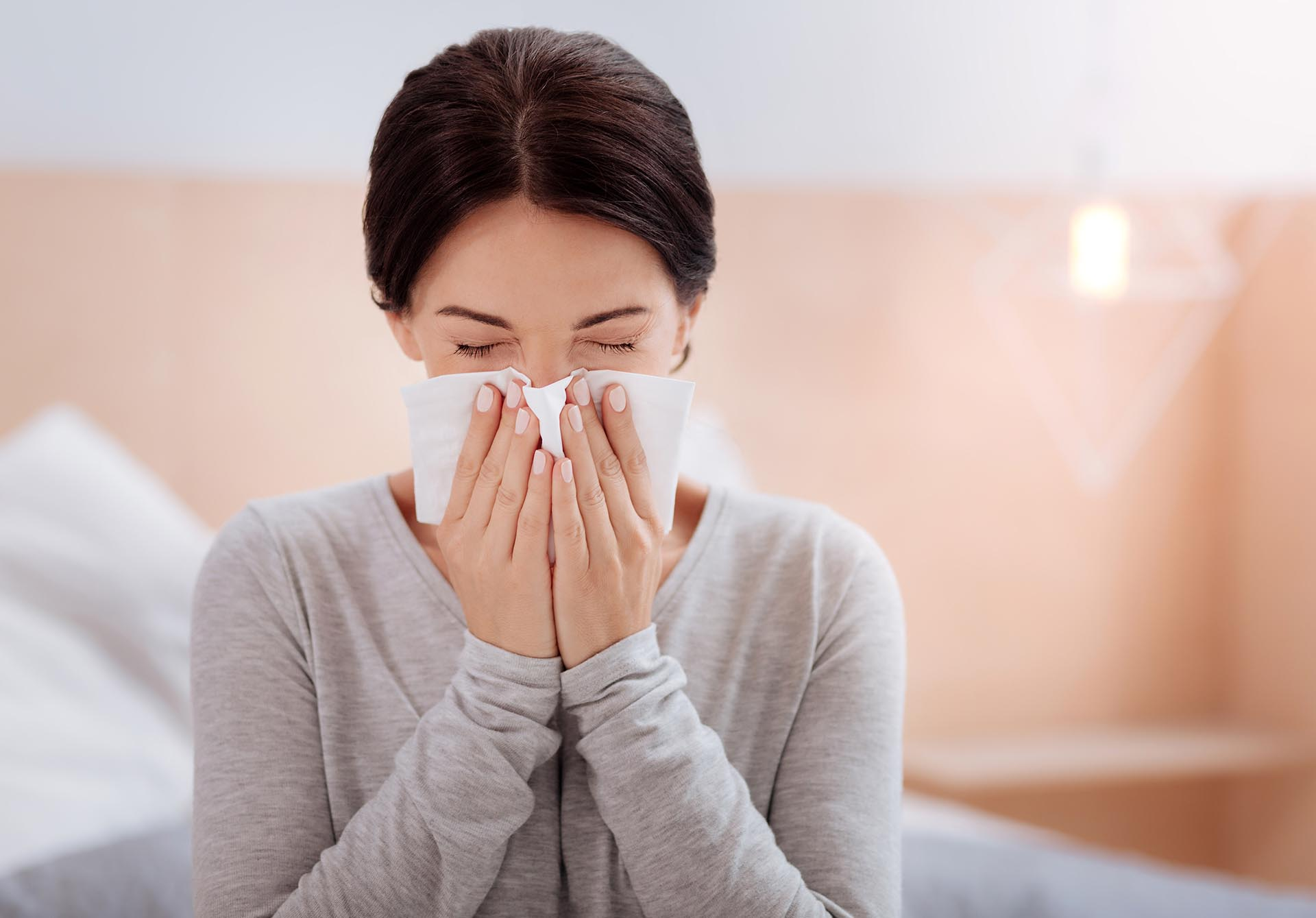 Woman sneezing with respiratory issues